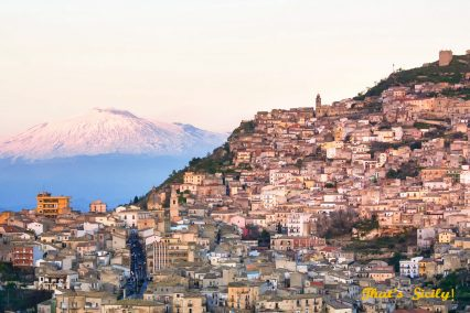 Italy, Sicily, Enna Province, Agira with the Mount Etna listed as World Heritage by UNESCO on the background